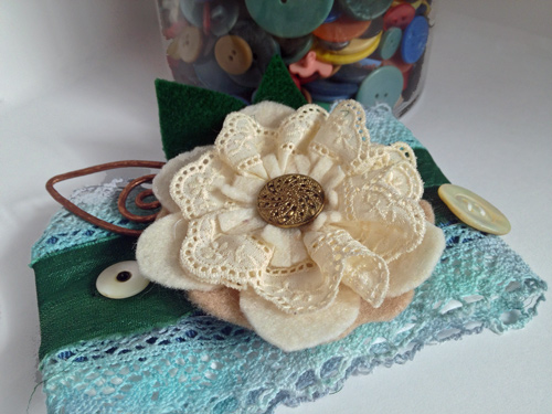 shirt cuff bracelet with hand dyed lace and mother-of-pearl buttons